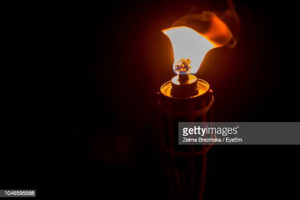 close-up of lit oil lamp in darkroom - brezinska stock pictures, royalty-free photos & images
