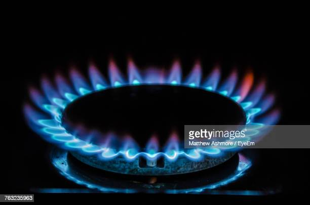 Close-Up Of Lit Stove Burner Against Black Background
