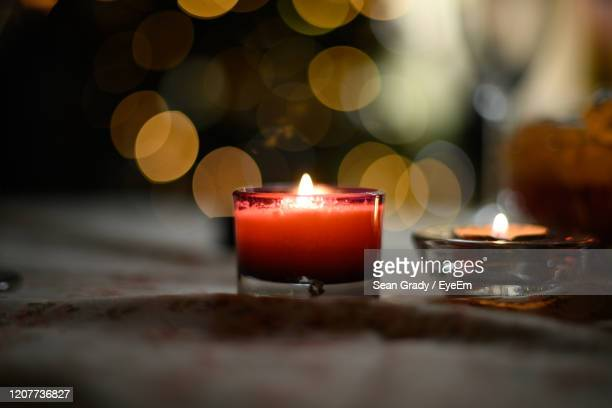 close-up of lit tea light candles - burning stock pictures, royalty-free photos & images