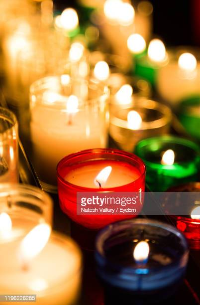close-up of lit tea lights - christmas decore candle stock pictures, royalty-free photos & images