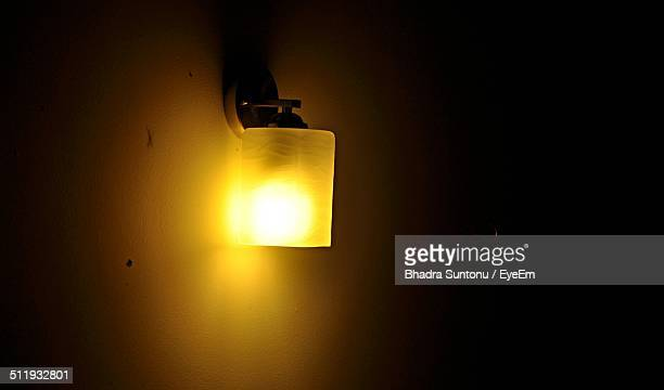 Close-up of lit wall lamp