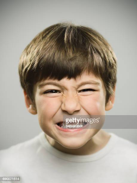 closeup of little boy looking angry - kid middle finger stock pictures, royalty-free photos & images