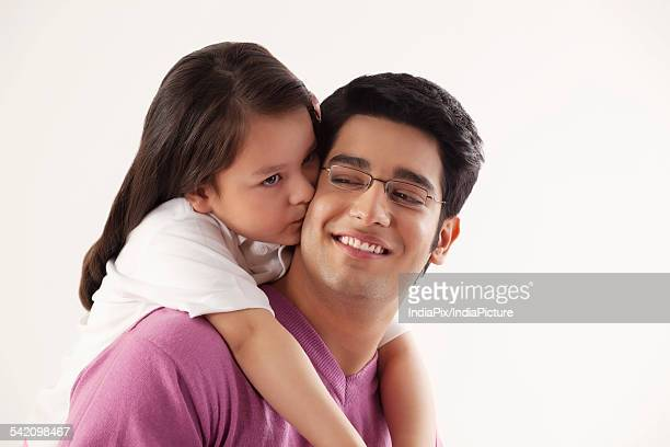 close-up of little girl kissing her father - indian girl kissing stock photos and pictures