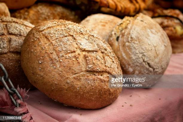 close-up of loaf on bread at table - per grunditz stock pictures, royalty-free photos & images