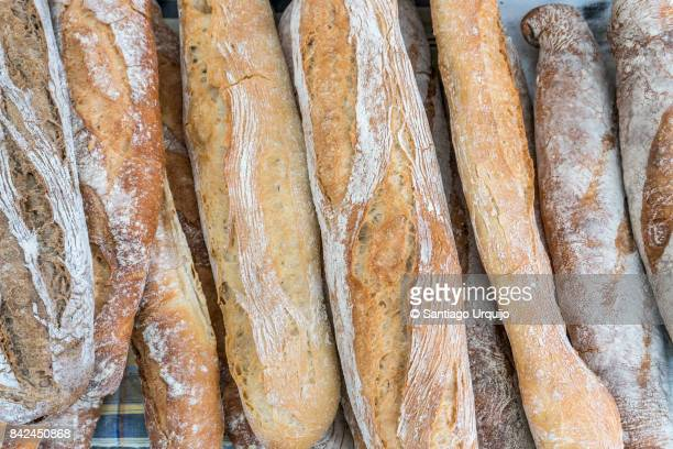 close-up of loaves of bread - baguette stock pictures, royalty-free photos & images