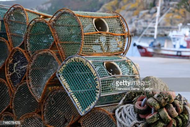 close-up of lobster traps at harbor - crab pot stock photos and pictures