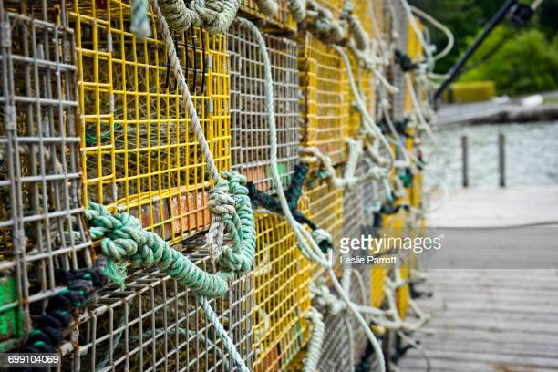 Closeup of lobster traps on a dock