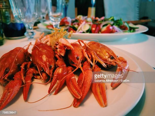 Close-Up Of Lobsters Served In Plate
