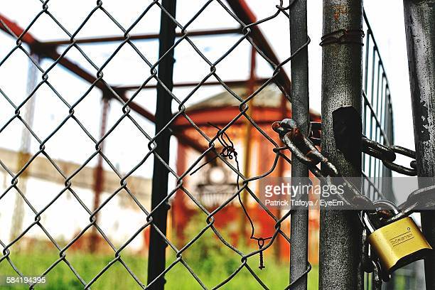 Close-Up Of Locked Chainlink Fence