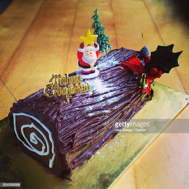 Close-Up Of Log Cake Served On Table At Home During Christmas