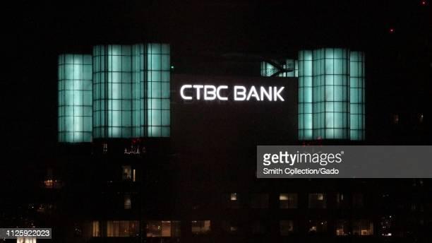 Closeup of logo atop CTBC Bank building at night in downtown Los Angeles California January 23 2019