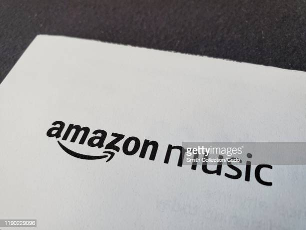 Closeup of logo for Amazon Music a division of Amazon Prime on paper on a dark surface November 25 2019