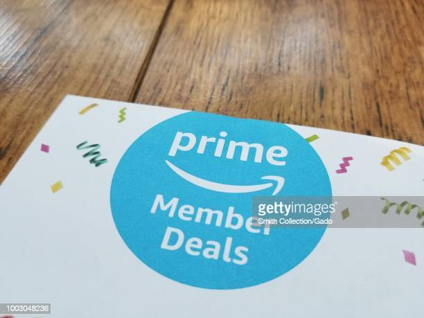 Closeup of logo for Amazon Prime deals on Prime Day on a paper on a light wooden surface San Ramon California July 18 2018