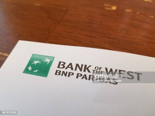 Closeup of logo for Bank of the West a division of BNP Paribas on a paper on a light wooden surface May 11 2018