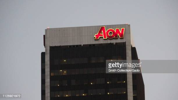Closeup of logo for British professional services company AON atop the AON building in downtown Los Angeles California January 23 2019