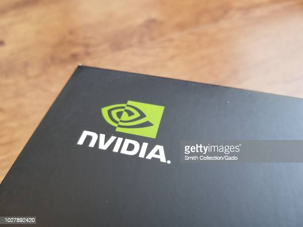 Close-up of logo for computer hardware company Nvidia against a light wooden surface, San Ramon, California, August 28, 2018.