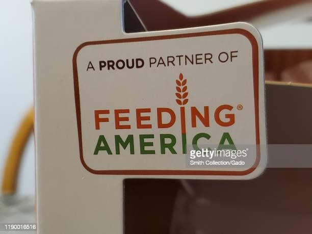 Closeup of logo for hunger charity Feeding America on product box San Ramon California November 23 2019