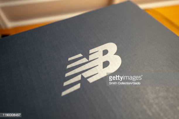 Closeup of logo for shoe company New Balance on a shoe box in a domestic room August 22 2019