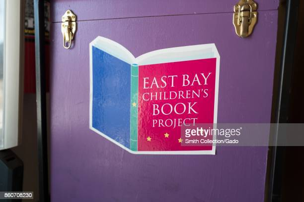 Closeup of logo on a drop box for the East Bay Children's Book Project charity which provides books for children in need in the Gourmet Ghetto...