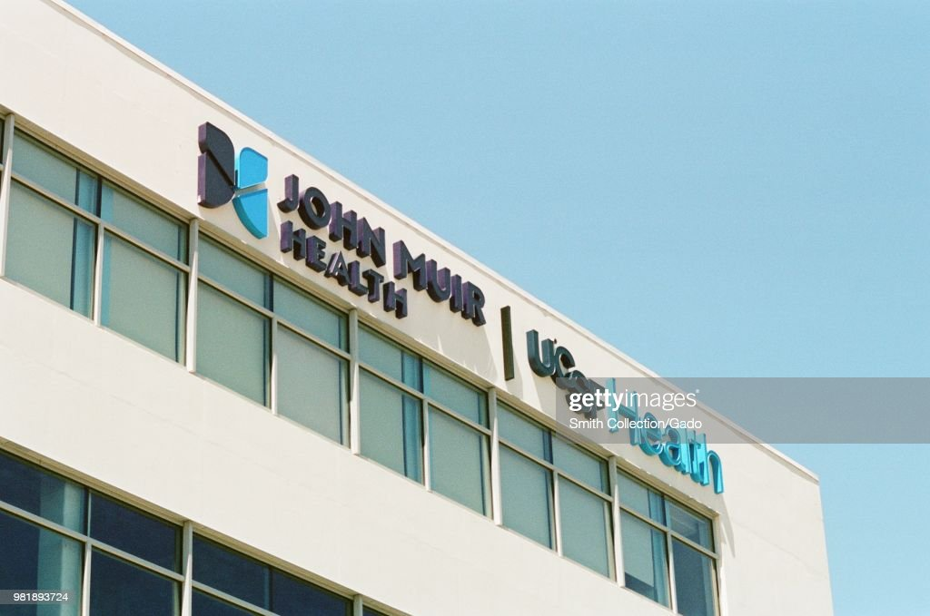 Close-up of logo on facade of combined John Muir health and