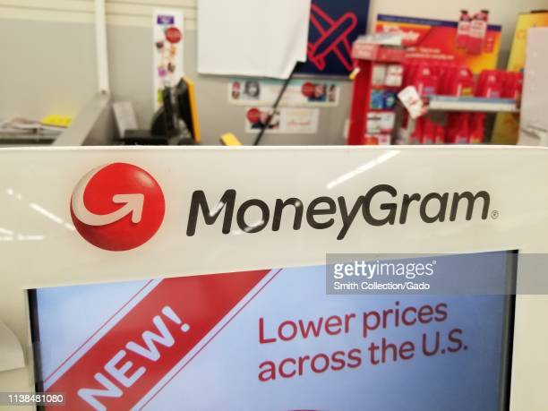 Closeup of logo on MoneyGram money transfer kiosk in a retail setting San Ramon California March 26 2019