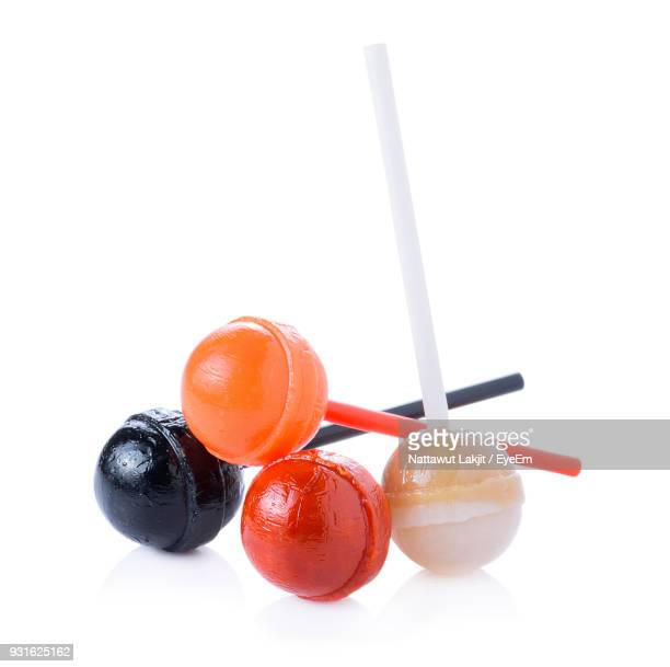 close-up of lollipops over white background - lollipop stock pictures, royalty-free photos & images