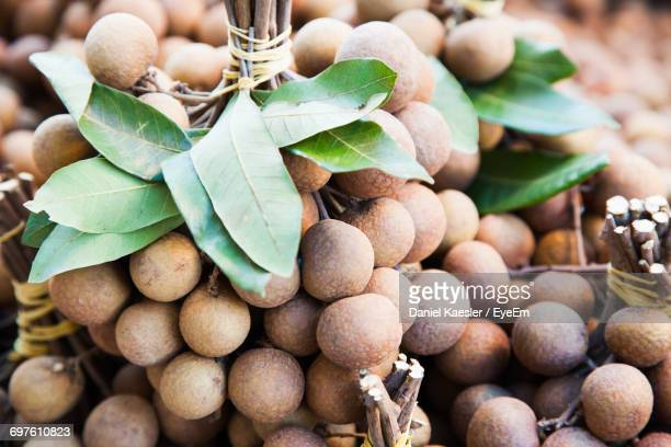 Close-Up Of Longan Fruits For Sale At Market