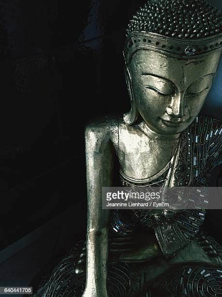 close-up of lord buddha statue in temple - lienhard stock pictures, royalty-free photos & images