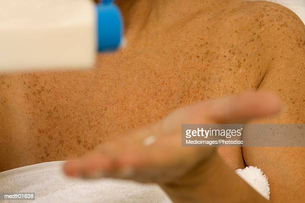 close-up of lotion squirting into a palm - squirt foto e immagini stock