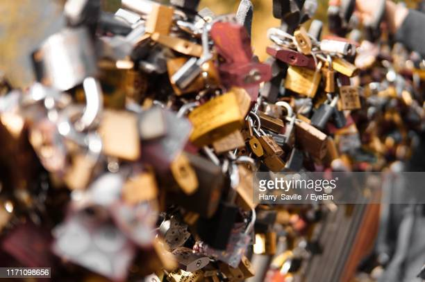 close-up of love locks on railing - bohemia czech republic stock pictures, royalty-free photos & images