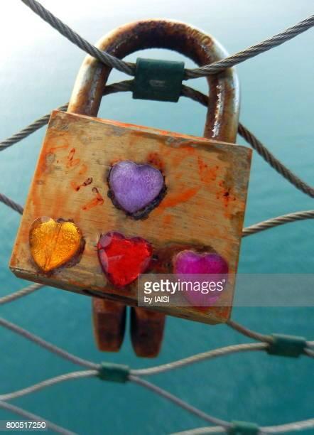 Close-up of love padlock at Tel Aviv harbor against sea
