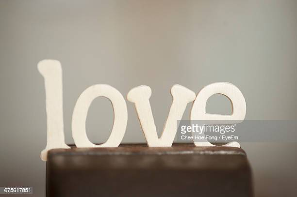 Close-Up Of Love Text On Wood During Valentines Day