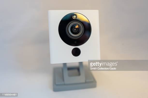 Closeup of lowcost webconnected personal surveillance camera from smart home company Wyze isolated on white background August 21 2019