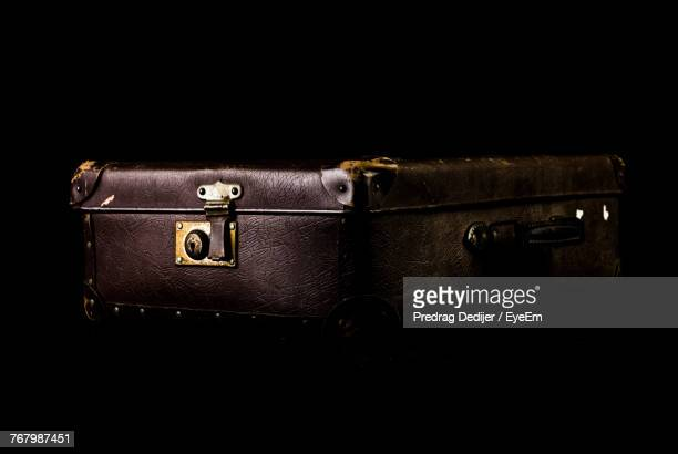 close-up of luggage over black background - briefcase stock photos and pictures