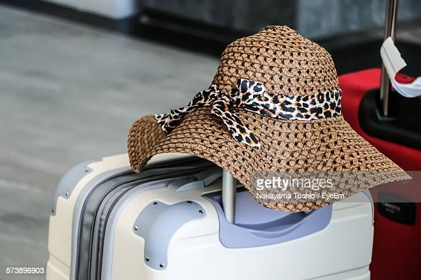 Close-Up Of Luggage With Sun Hat