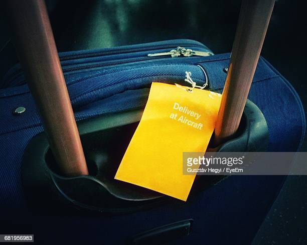 Close-Up Of Luggage With Yellow Tag