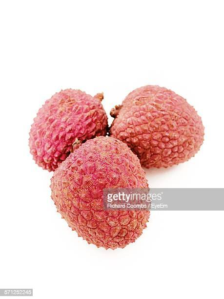 Close-Up Of Lychees Against White Background