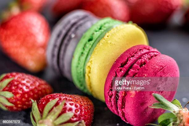 Close-Up Of Macaroons And Strawberries On Table