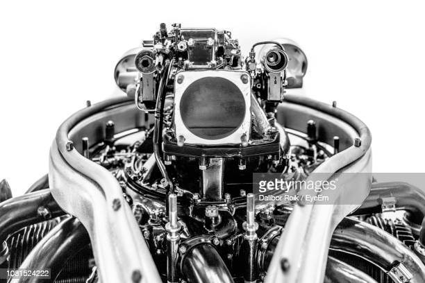 close-up of machine part against white background - engine stock pictures, royalty-free photos & images