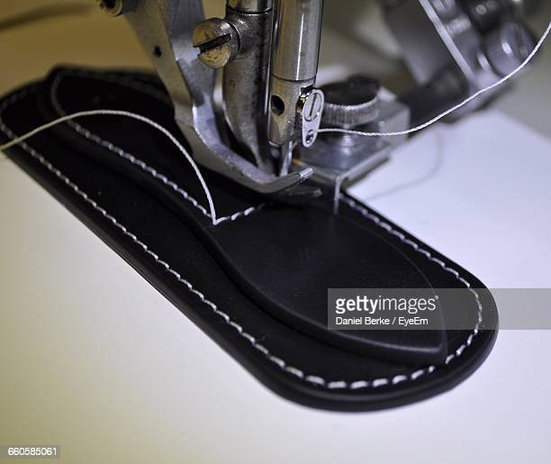 Close-Up Of Machine Sewing Shoes