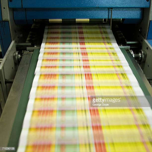 Close-up of magazines being produced