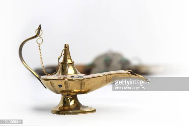 close-up of magic lamp against white background - lampara de aladino fotografías e imágenes de stock