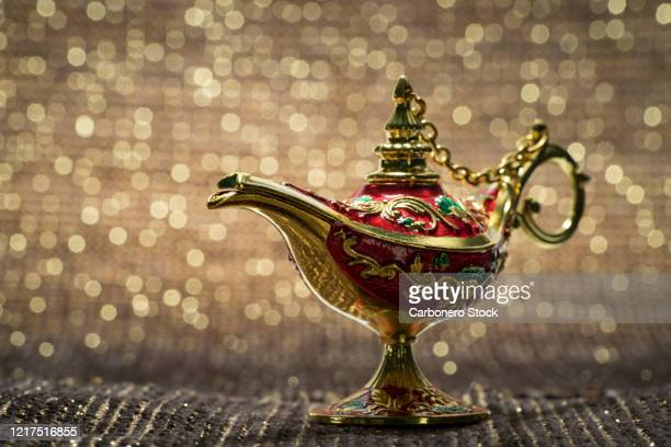 close-up of magic lamp - treasuregold stock pictures, royalty-free photos & images