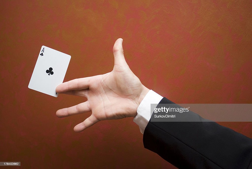 Close-up of magician performing trick with ace card : Stock Photo