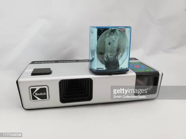 Closeup of Magicube flash cube installed in Kodak Pocket Instamatic 10 vintage camera ca 1970s on a white background September 26 2019