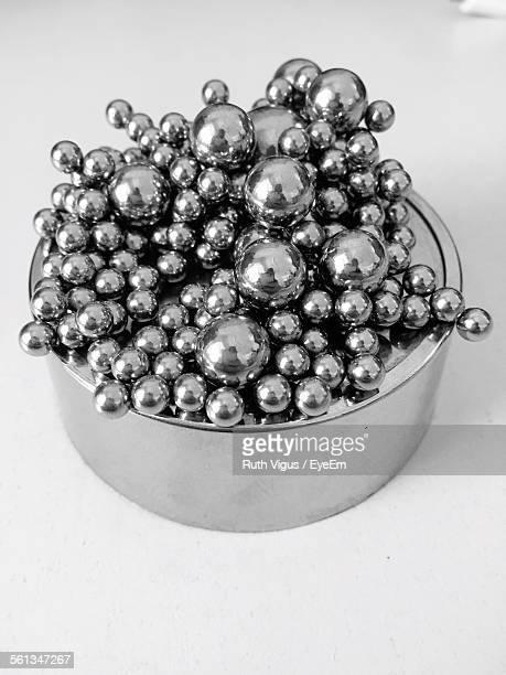 Close-Up Of Magnetic Balls On Container