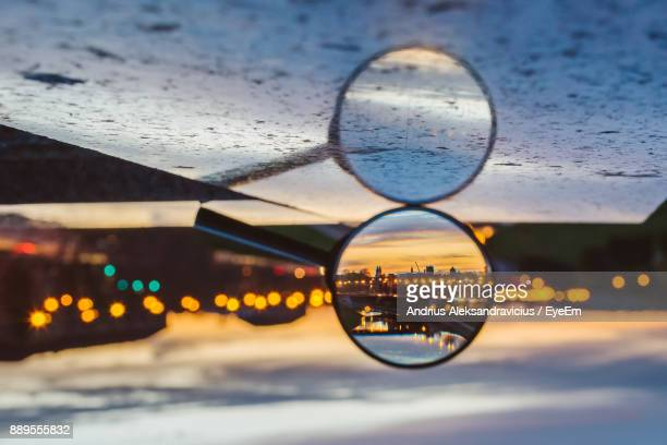 close-up of magnifying glass in table - magnifying glass stock pictures, royalty-free photos & images