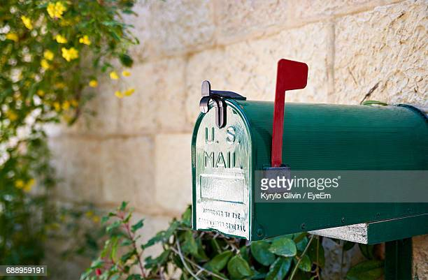 close-up of mailbox mounted on wall - mailbox stock pictures, royalty-free photos & images