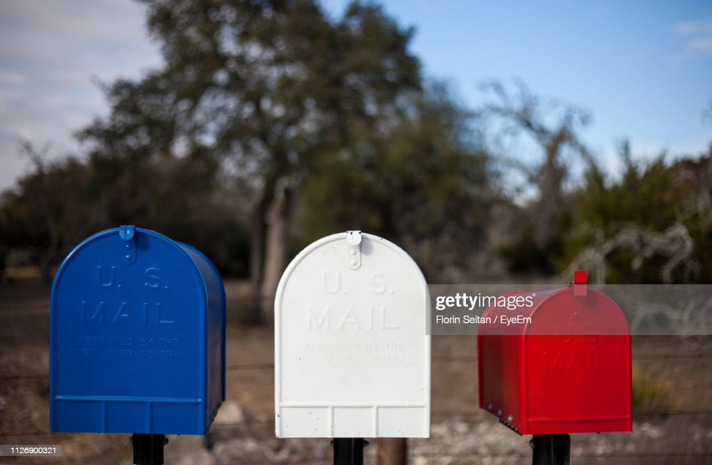 Close-Up Of Mailboxes Against Trees : Stock Photo