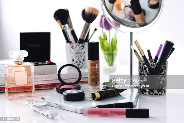 close-up of make-up products on table - cosmetics stock pictures, royalty-free photos & images